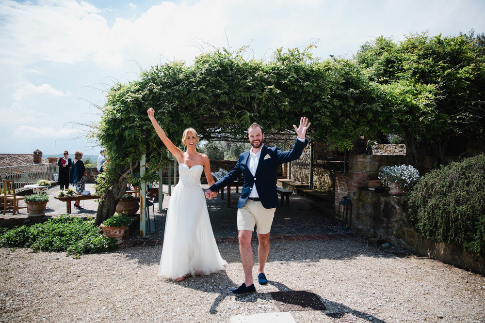 bride and groom celebrate and cheer after wedding ceremony ends