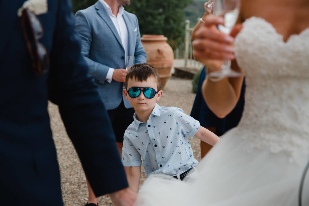 page boy in blue sunglasses posing for camera