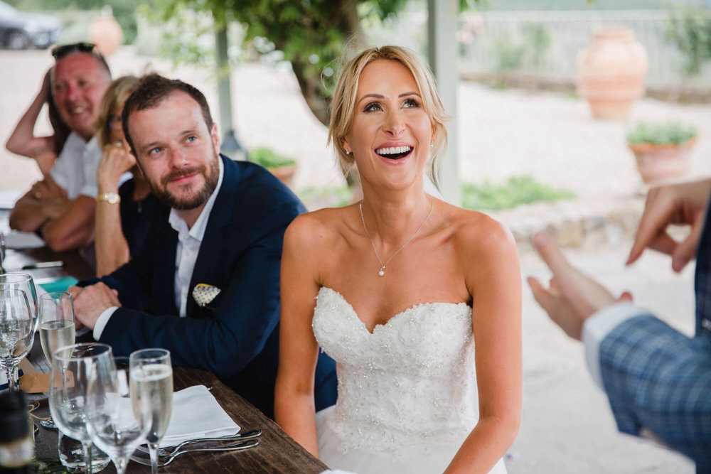 bride laughing at best man speech