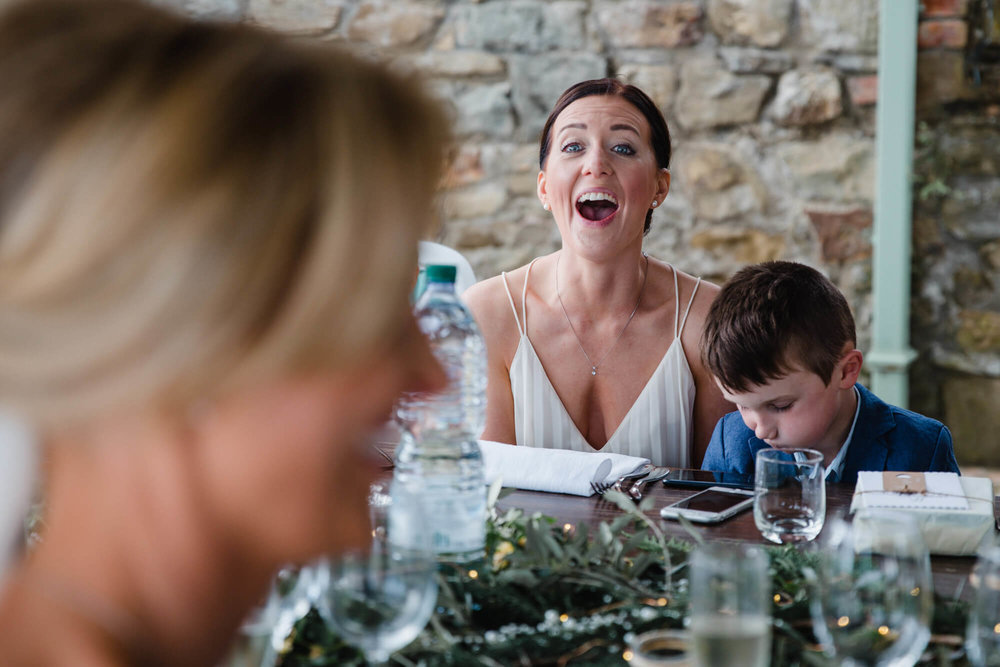 wedding guest with shocked expression at speeches