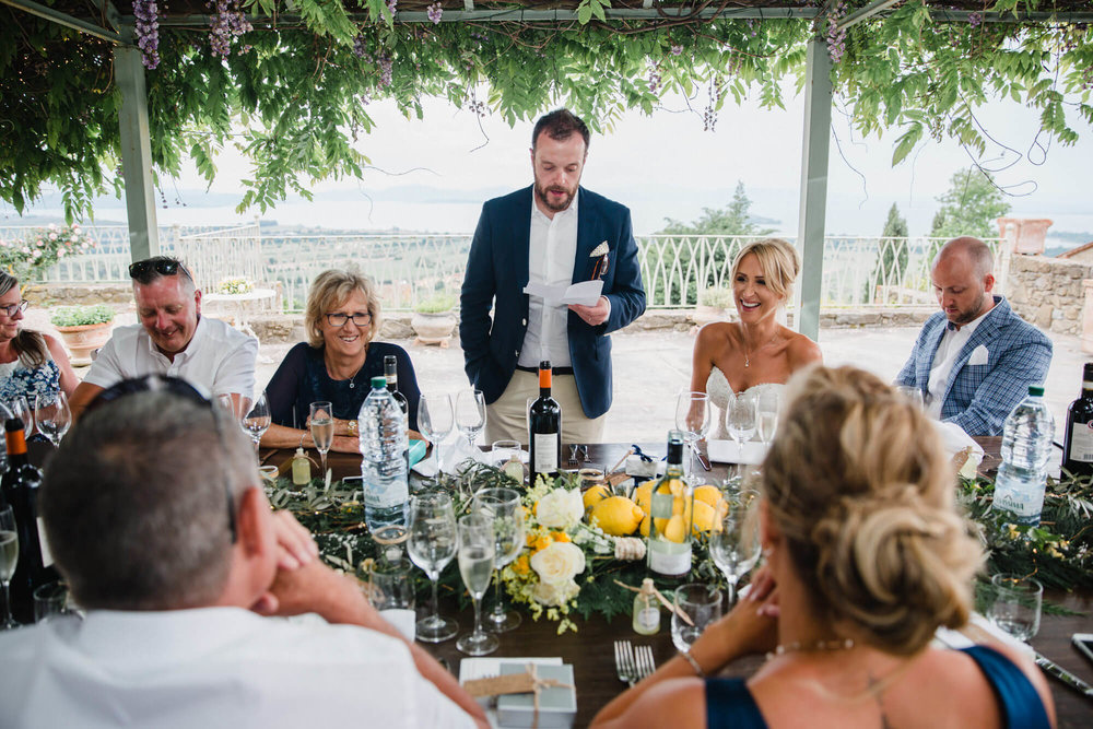 groom making speech to friends and family