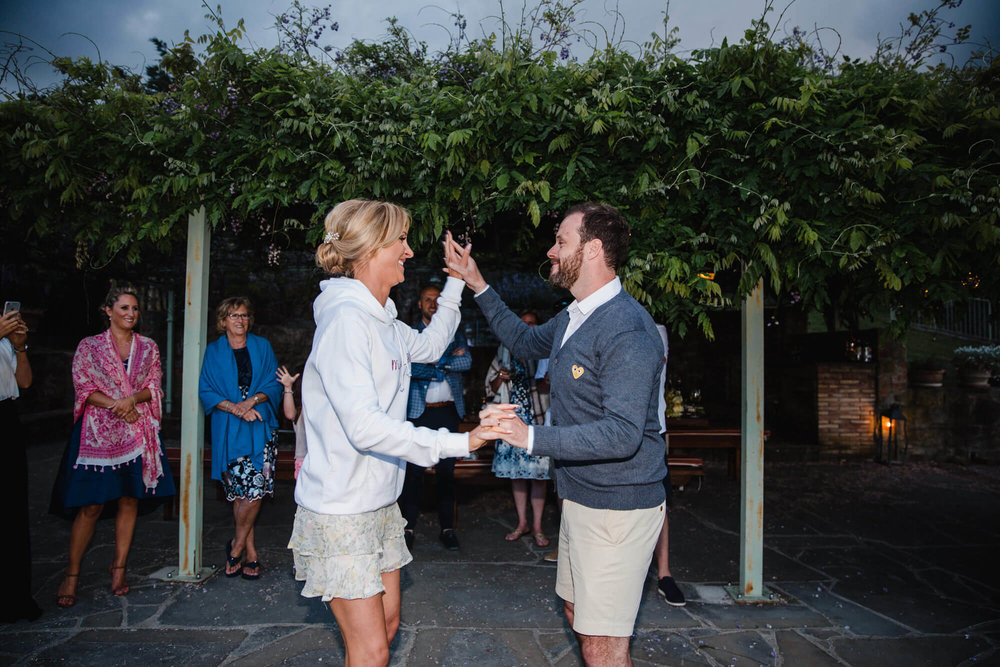 bride and groom first dance on balcony of tuscany wedding villa