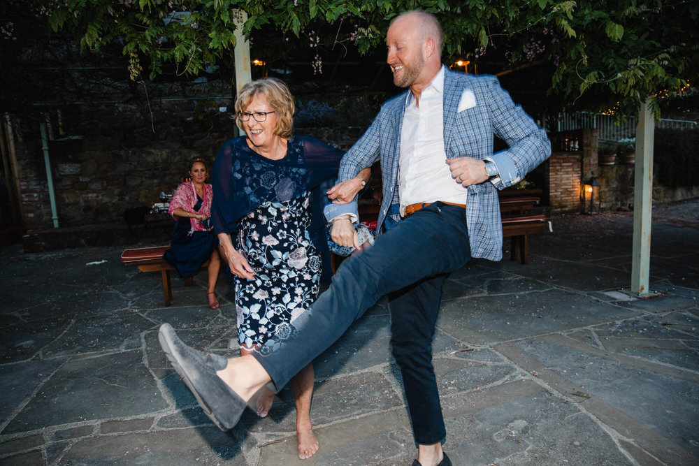 groomsman dances with mum at the end of the night