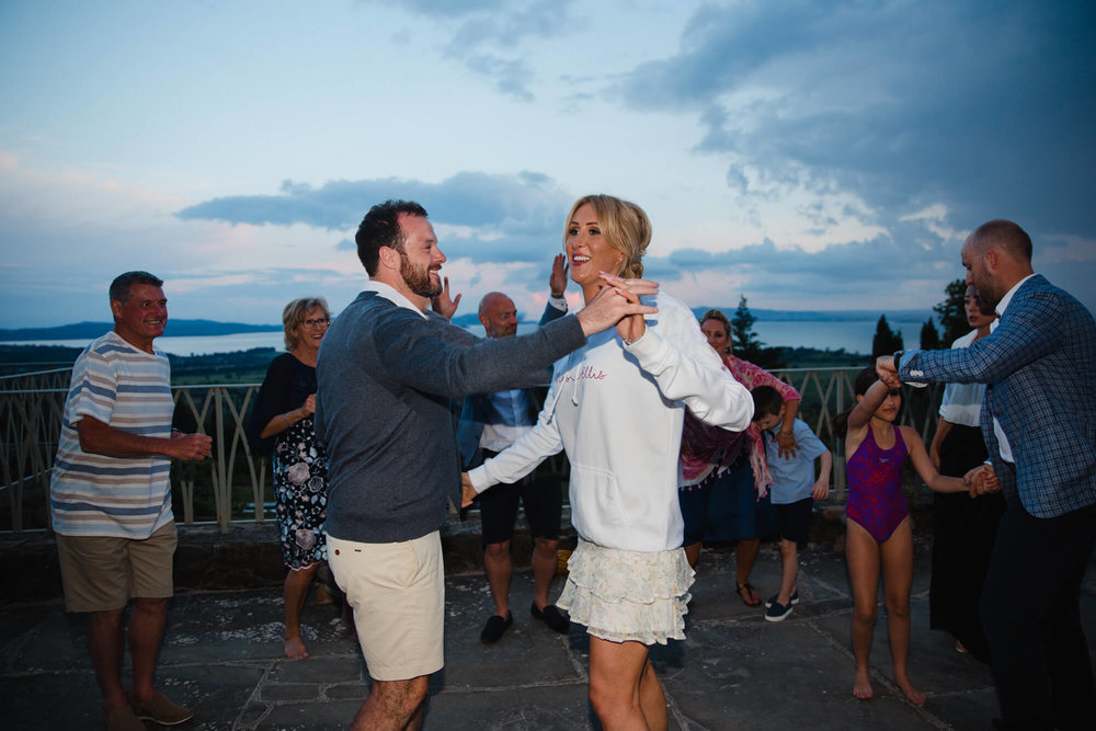 newlyweds dance into the night on terrace at Italian villa