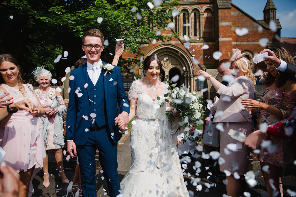 close up photograph of bride and groom receiving confetti
