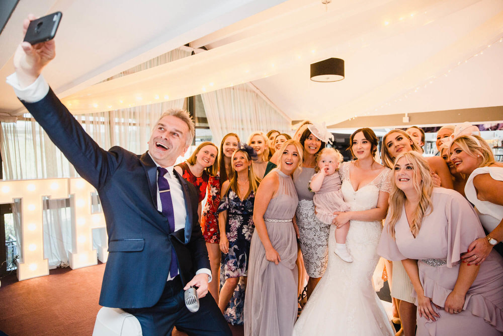 Award winning wedding singer Paul Guard sharing selfie photograph with bride and friends