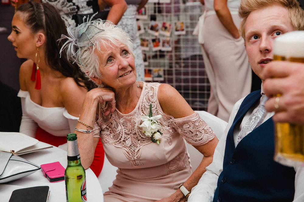 grandmother of bride chats to wedding guests