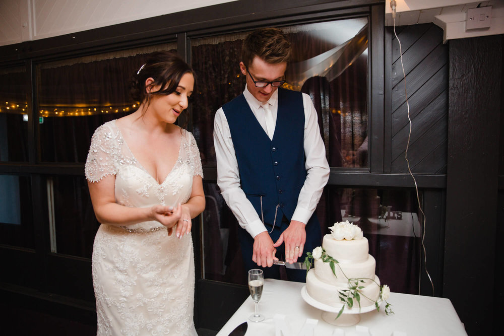 bride and groom cutting wedding cake at Waterside Hotel