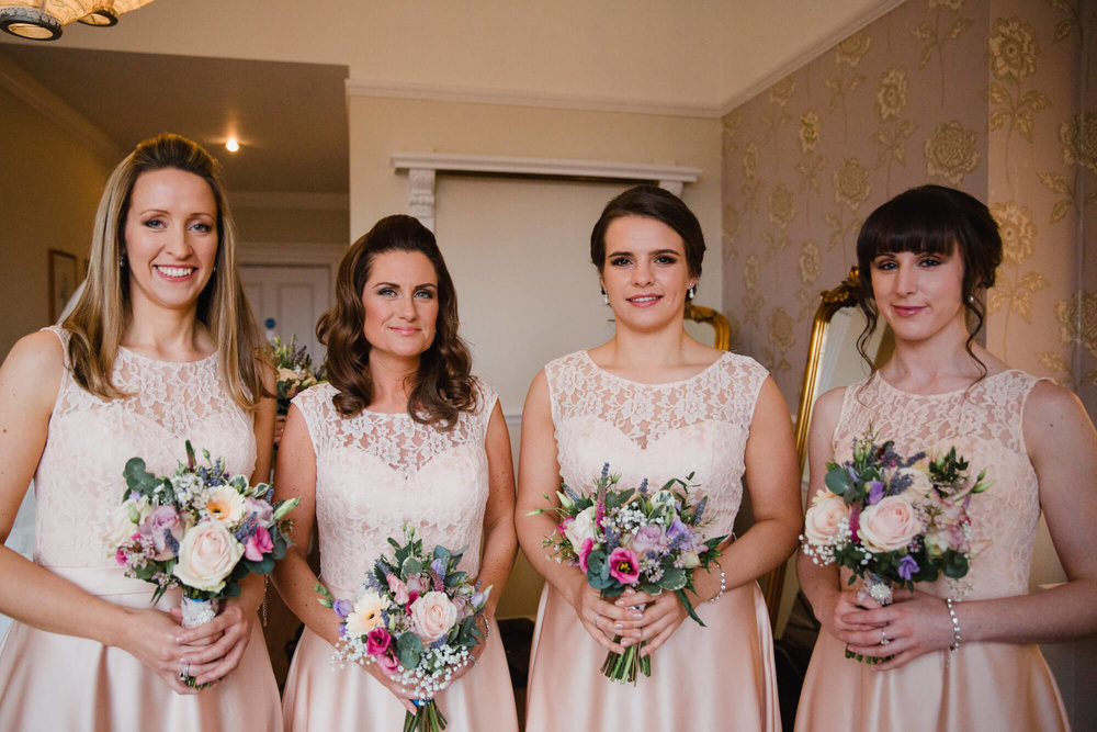 Posed bridal portrait of bridesmaids holding bouquets