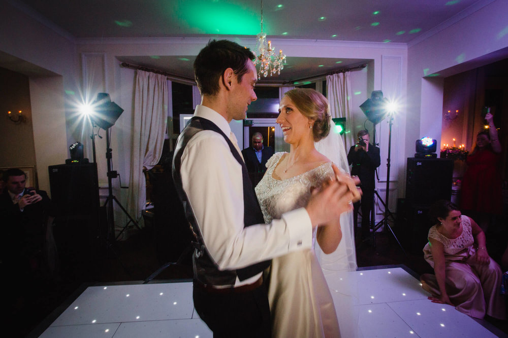 Newlyweds share first dance together on dance floor