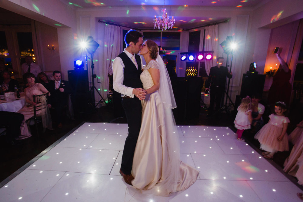 bride and groom kissing to first dance song at Ashfield House