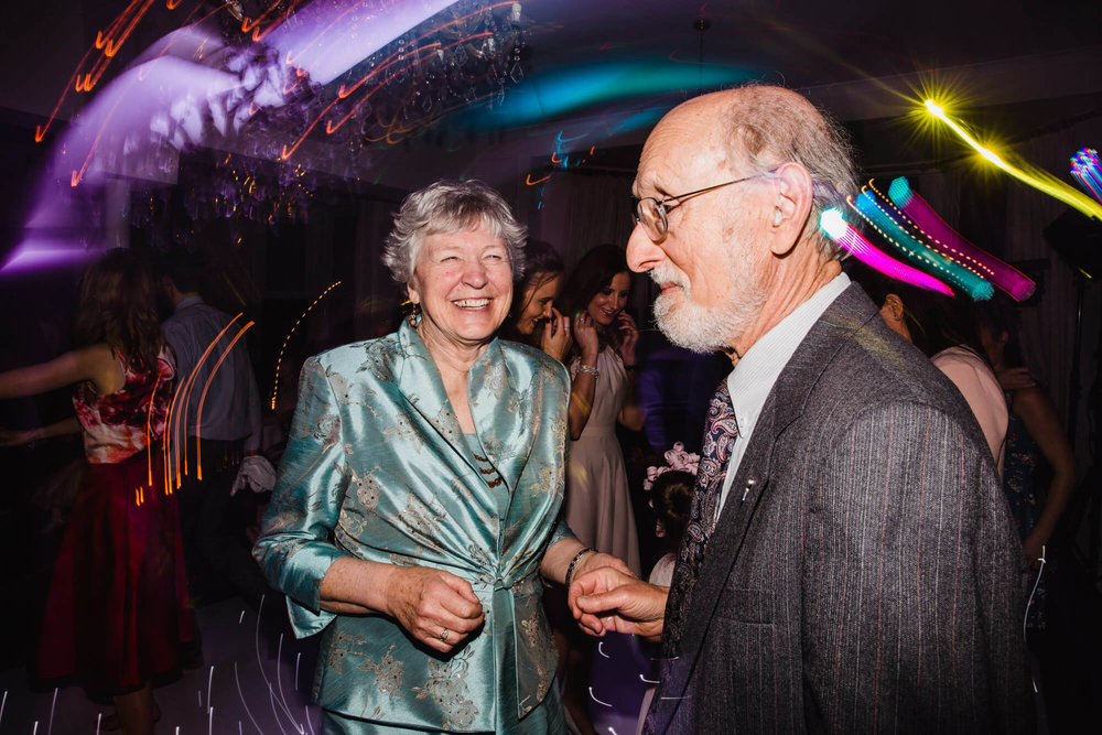 grandparents partying and smiling to camera at Ashfield House