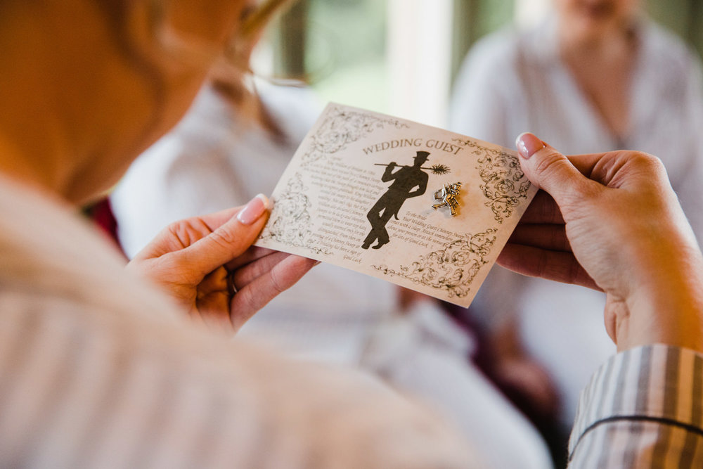 Close up macro photograph of bride holding wedding guest card