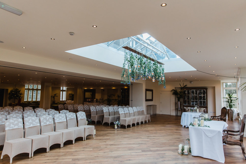 Wide angle photograph of ceremony room