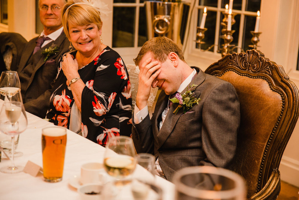 Groom sat with head in hands at speech
