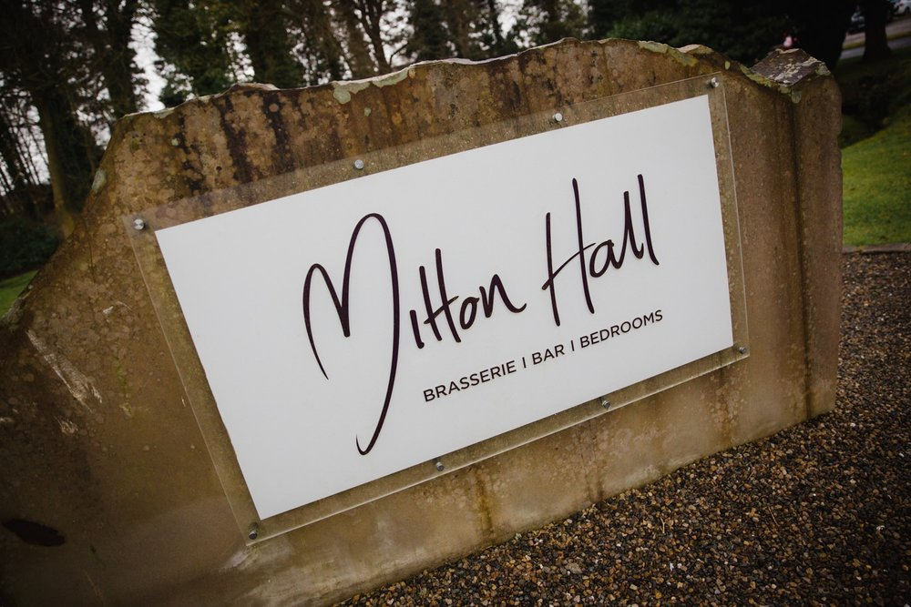 Mitton Hall entrance sign on arrival at wedding venue