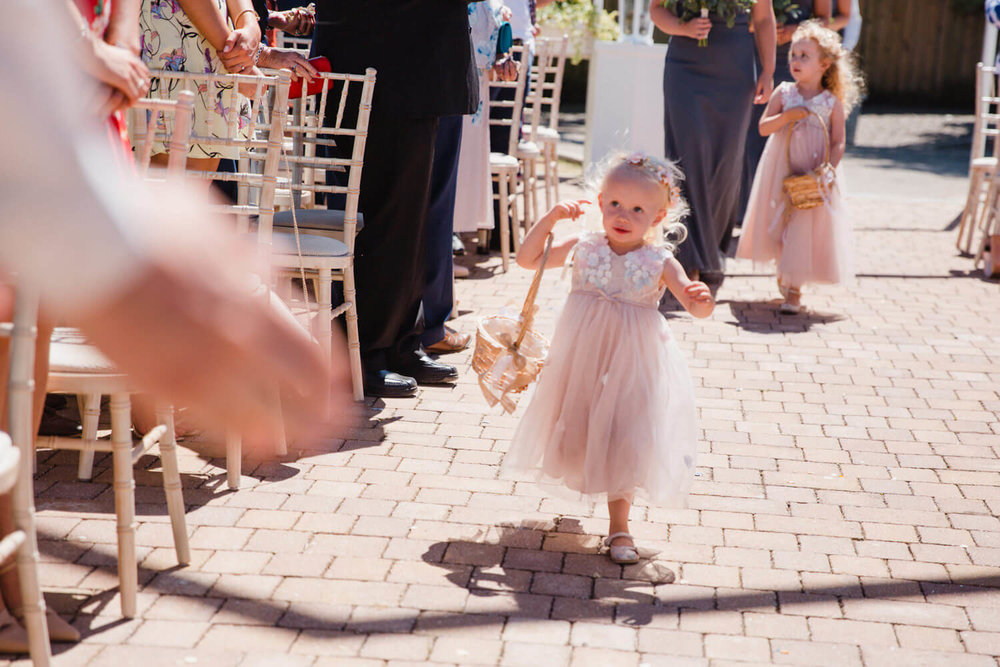flower girl running to groom