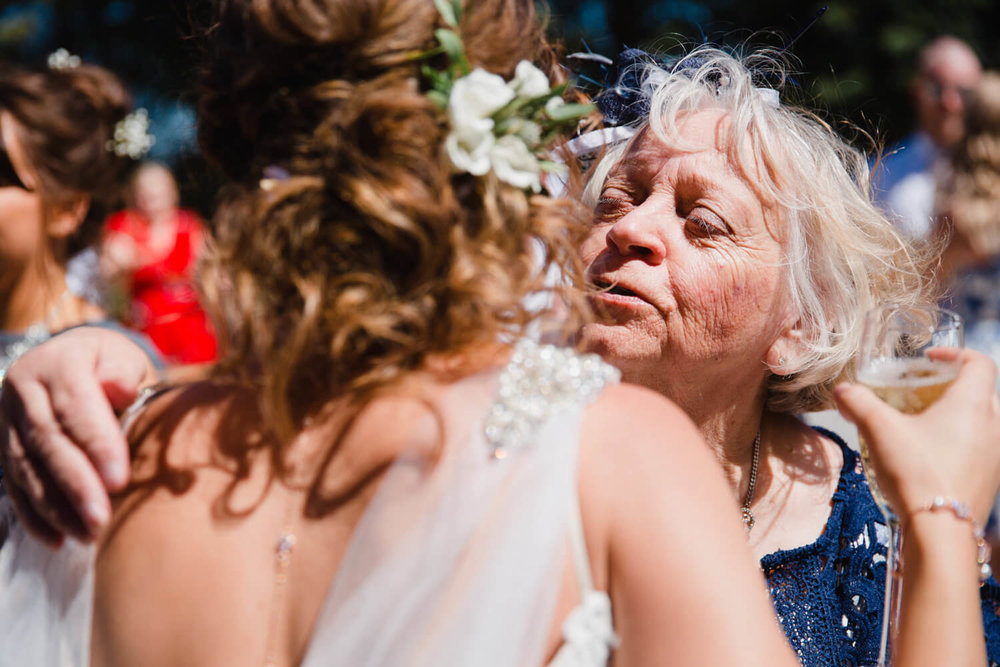 close up of grandma sharing intimate hug with bride