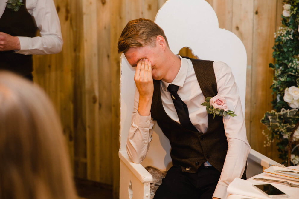 groom with head in hands embarrassed by speech