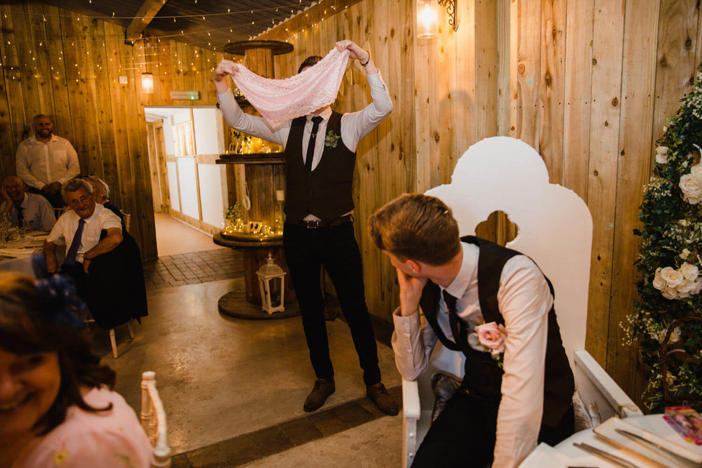 best man revealing large pink underwear during speeches