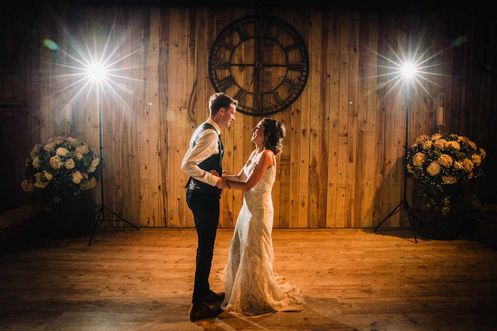 wide angle lens photograph of newlyweds dancing to first dance