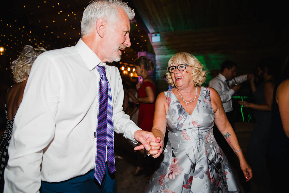 parents dancing and partying to wedding music