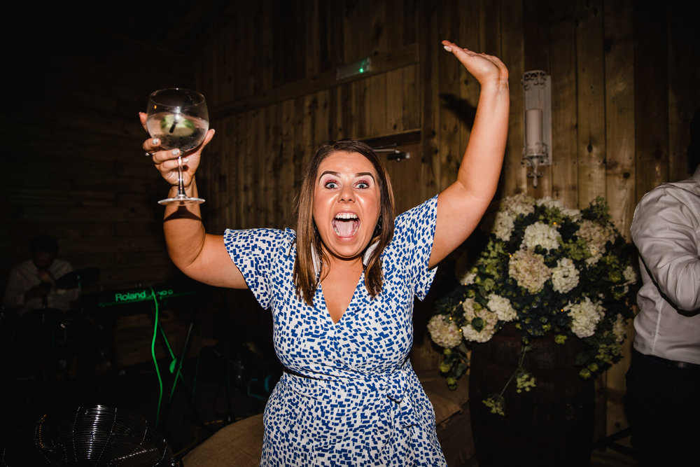 wedding guest partying to camera