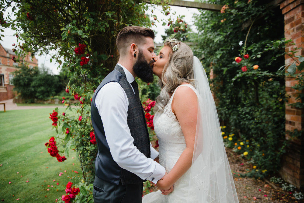 Nicole and Liam in the Rose Garden of Willington Hall