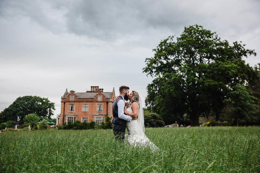 Portraits in the corn fields with Willington Hall as the backdrop