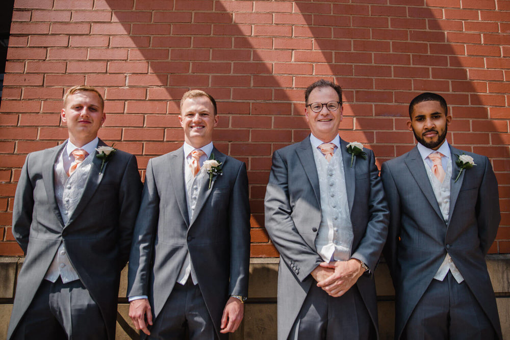 group shot photograph of groom with best men