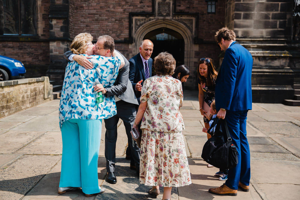 guests hugging and greeting outside church