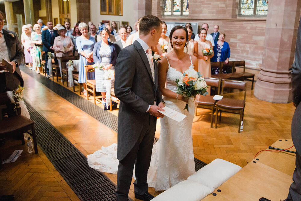 bride and groom at top of aisle in church