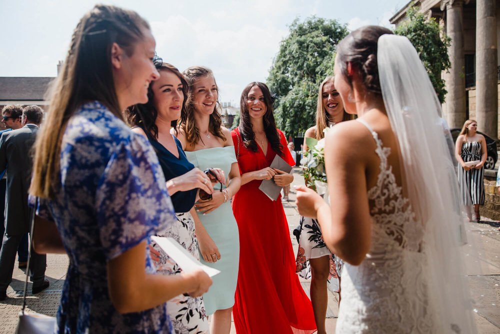 brides friends share joke with bride