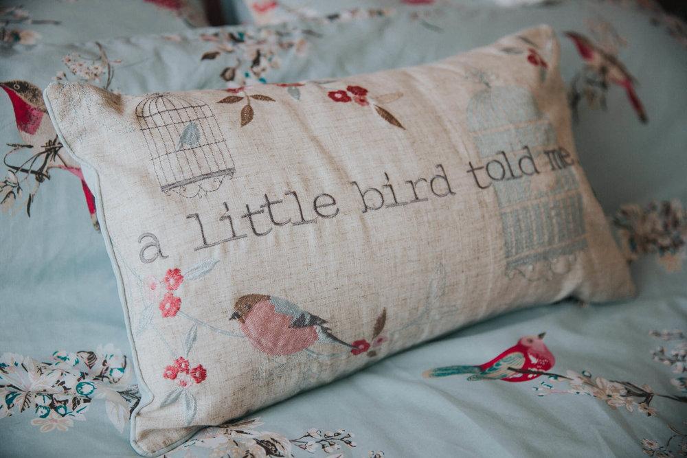 little bird pillow in bridal bedroom