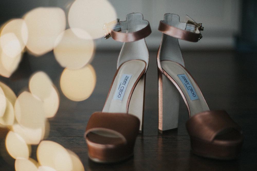 jimmy choo wedding shoes on floor of bridal suite