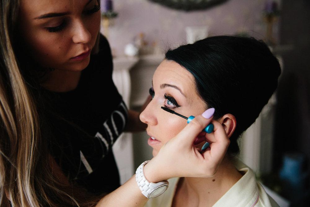 close up macro lens photograph of bride having make up preparation