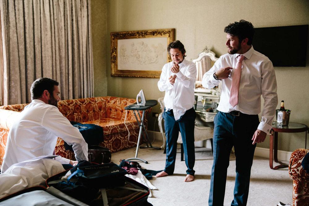 groomsmen preparing in suite of 30 James Street