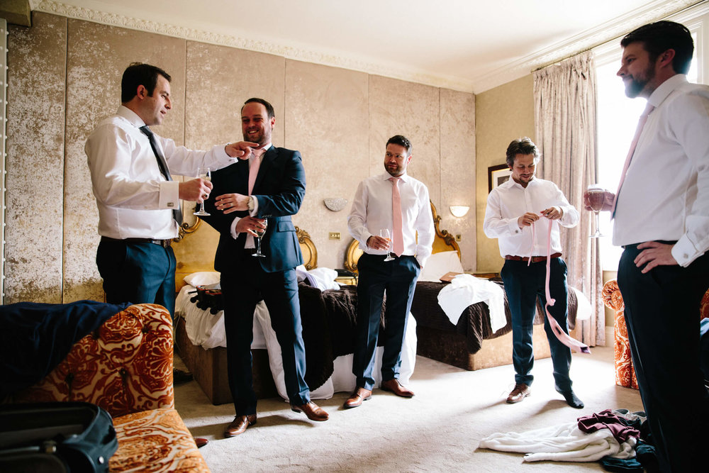 all groomsmen together laughing and joking