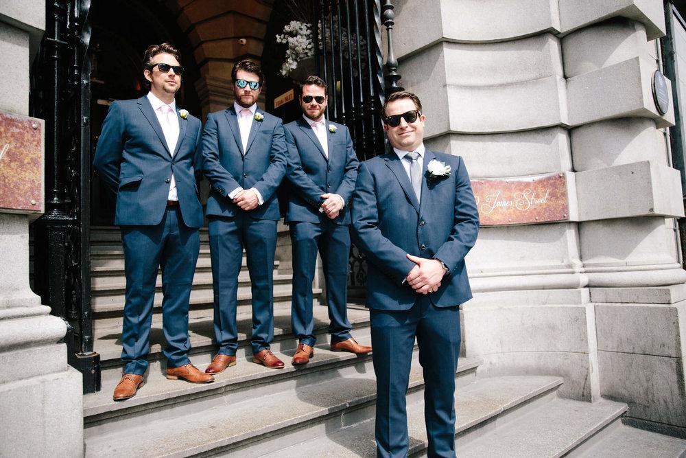 groom and best man groomsmen on steps to 30 James Street