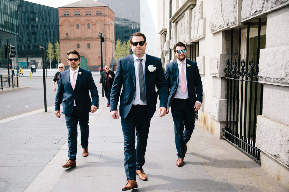 Groomsmen walking down Liverpool street together