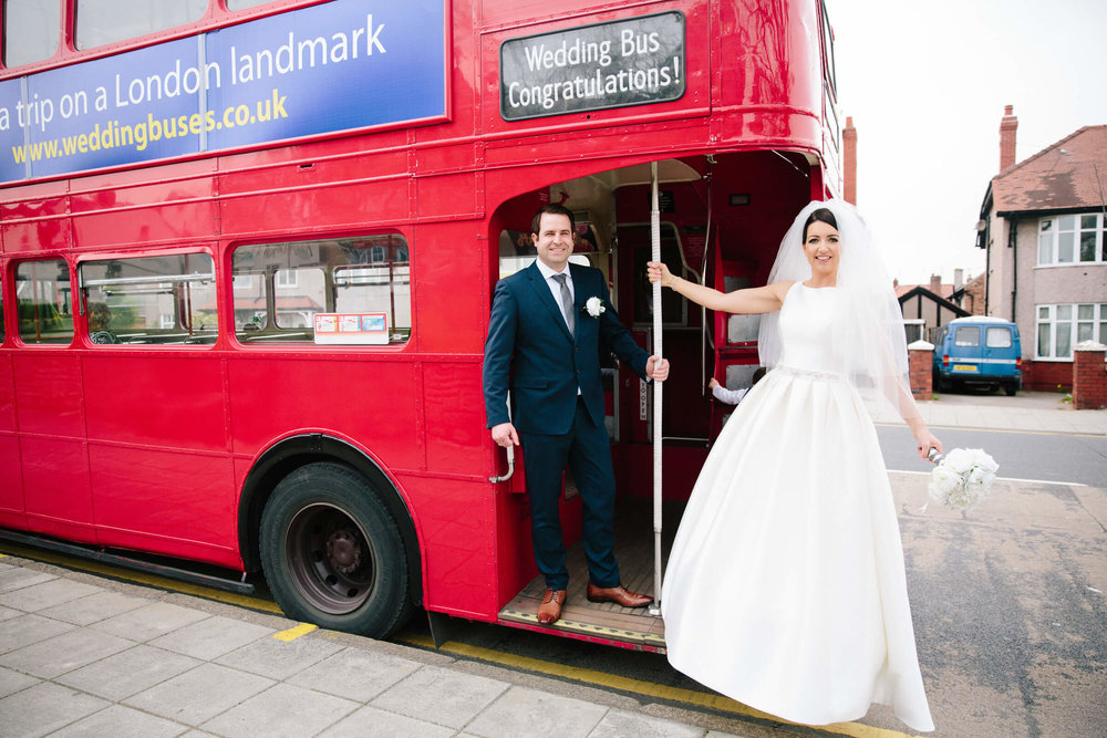 photograph of newlyweds on back of bus