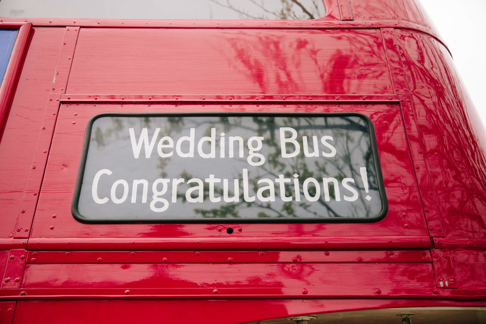 close up macro lens photograph of wedding bus congratulations sign