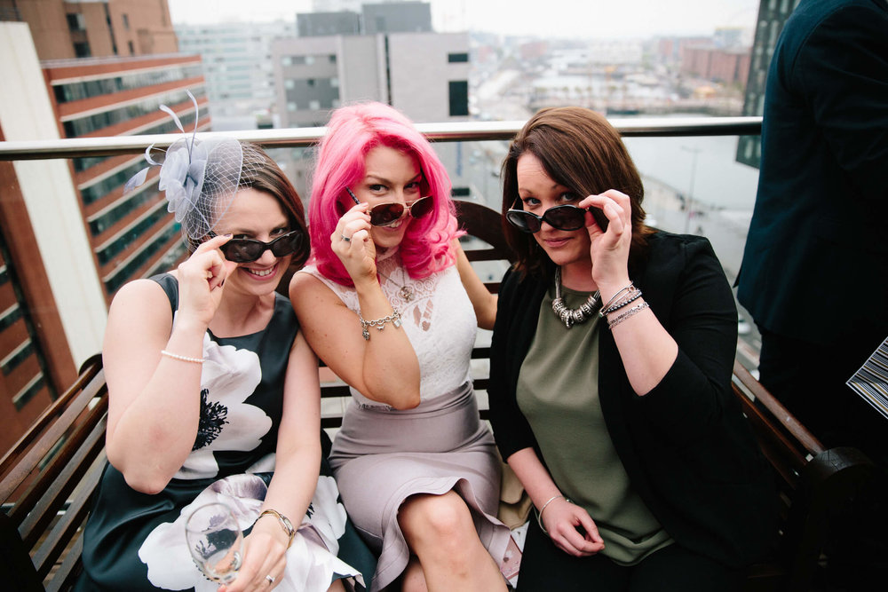 wedding guests on balcony at top of 30 James Street