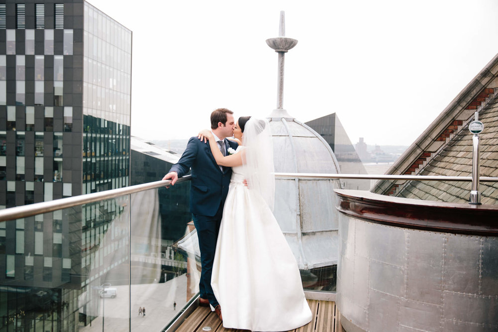 Newly wedding portrait of bride and groom on top of 30 james street wedding venue