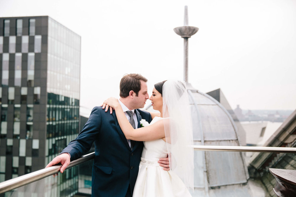 close up portrait photograph of bride and groom holding one another