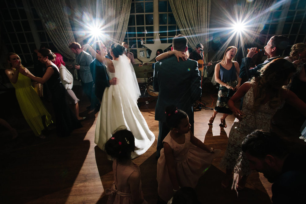full dance floor with band playing music