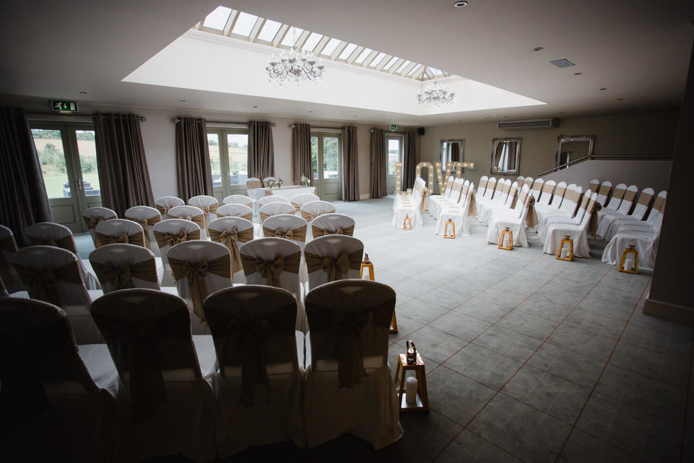 wide angle lens photograph of ceremony room at peak edge hotel