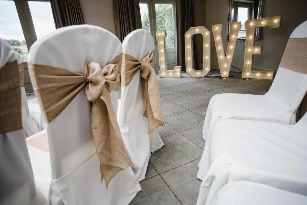 Love lighting lettering in ceremony room