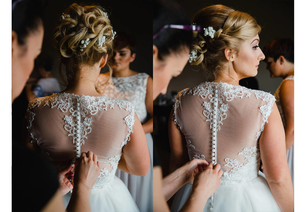 macro lens photograph of detailed dress back being fastened