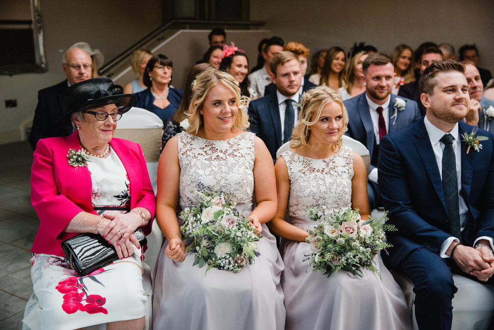 bridal party smiling at peak edge hotel wedding ceremony